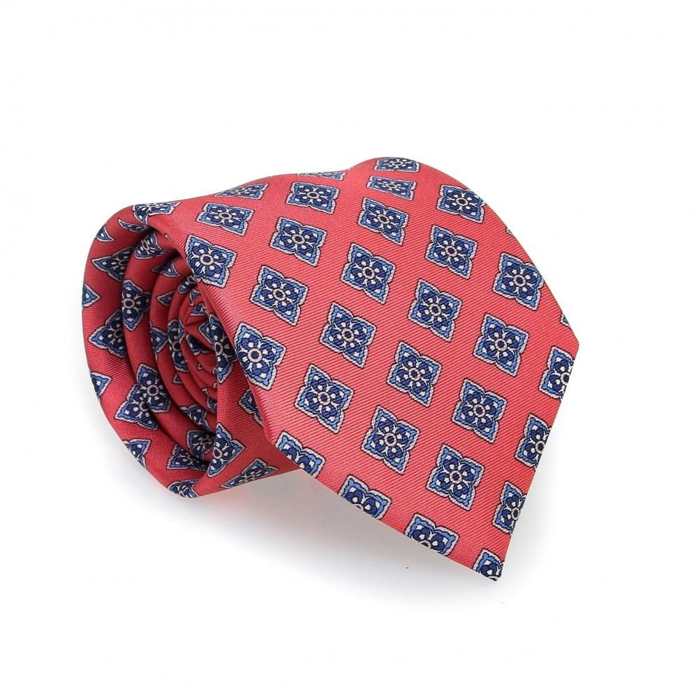 Cravate en soie : Base saumon - Motif fleurette bleu et blanc